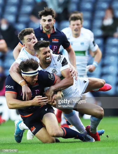 Hamish Watson of Edinburgh is tackled by Adam Hastings of Glasgow during the Guinness Pro14 match between Edinburgh and Glasgow at Murrayfield on...