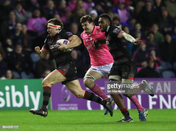 Hamish Watson of Edinburgh Rugby brakes away to score his team's first try during the European Rugby Challenge Cup match between Edinburgh and Stade...