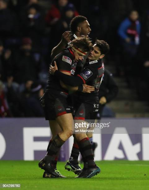 Hamish Watson of Edinburgh Rugby is congratulated on scoring a try by team mate Sam HidalgoClyne during the European Rugby Challenge Cup match...