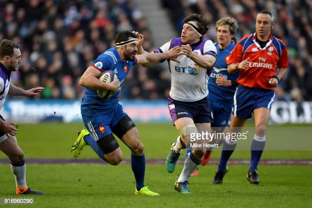 Hamish Watson of Scotland attempts to tackle Geoffrey Doumayrou of France during the NatWest Six Nations match between Scotland and France at...