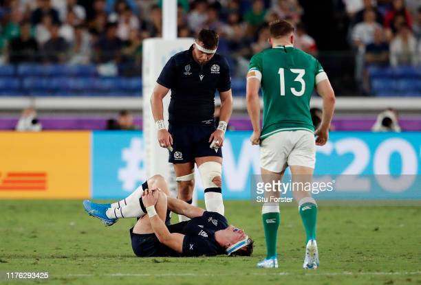 Hamish Watson of Scotland lies on the pitch holding his knee as he gets injured during the Rugby World Cup 2019 Group A game between Ireland and...