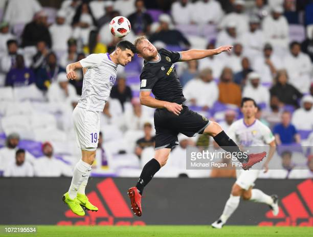 Hamish Watson of Team Wellington and Mohanad Salem of Al Ain jump for the ball during the FIFA Club World Cup first round playoff match between Al...