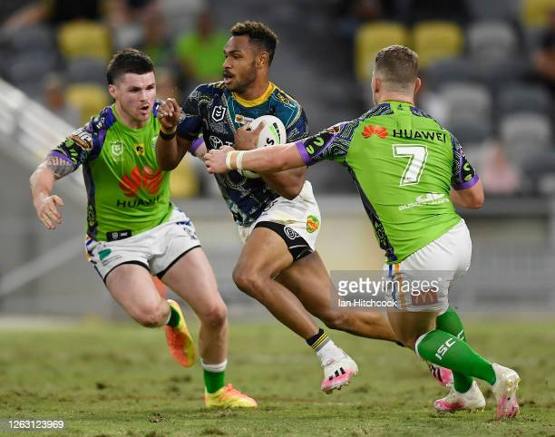 Hamiso TabuaiFidow of the Cowboys runs the ball during the round 12 NRL match between the North Queensland Cowboys and the Canberra Raiders at QCB...