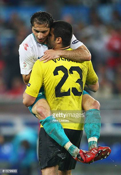 Hamit Altintop and goalkeeper Volkan Demirel of Turkey celebrate victory after the UEFA EURO 2008 Group A match between Switzerland and Turkey at St...