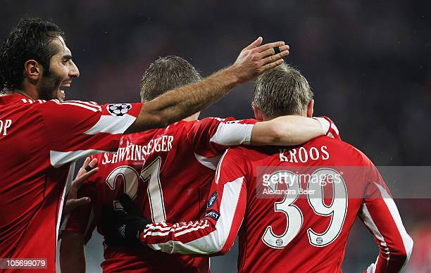 Hamit Altintop, Bastian Schweinsteiger and Toni Kroos of Bayern Muenchen celebrate an own goal of Cadu of Cluj during the UEFA Champions League group...