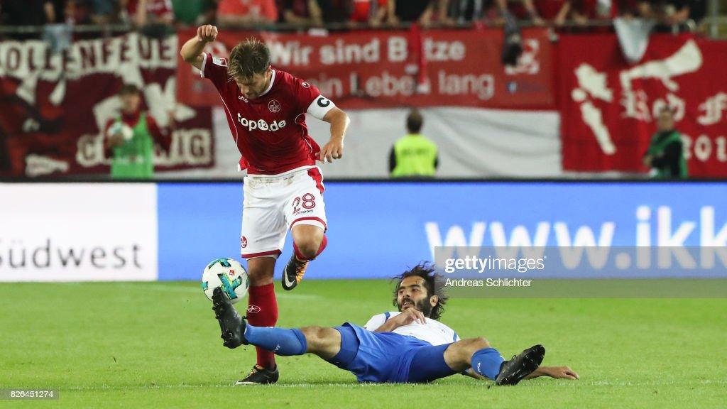 Hamit Altintop of Darmstadt challenges Daniel Halfar of Kaiserslautern during the Second Bundesliga match between 1. FC Kaiserslautern and SV Darmstadt 98 at Fritz-Walter-Stadion on August 4, 2017 in Kaiserslautern, Germany.