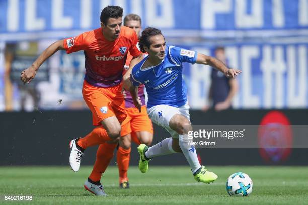 Hamit Altintop of Darmstadt is challenged by Anthony Losilla of Bochum during the Second Bundesliga match between SV Darmstadt 98 and VfL Bochum 1848...