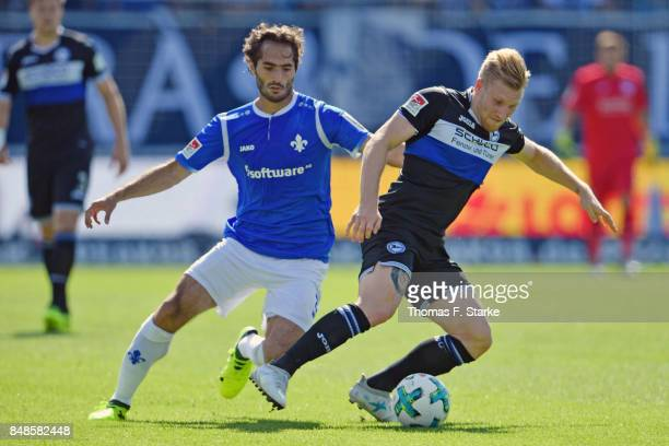 Hamit Altintop of Darmstadt tackles Andreas Voglsammer of Bielefeld during the Second Bundesliga match between SV Darmstadt 98 and DSC Arminia...