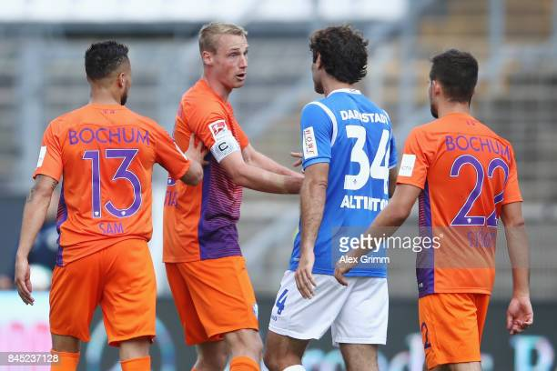 Hamit Altintop of Darmstadt talks to Felix Bastians of Bochum after Bastians admitted a diver and made referee Benedikt Kempkes take back his penalty...