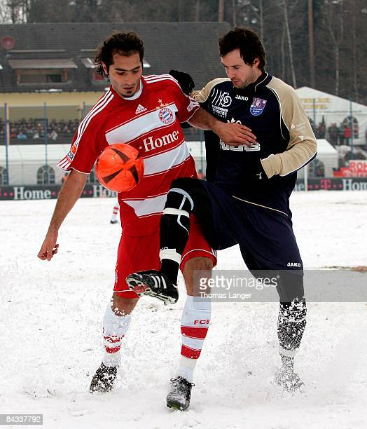 Hamit Altintop of Munich and Christoph Kaiser of Bamberg battle for the ball during the friendly match between FC Eintracht Bamberg and FC Bayern...