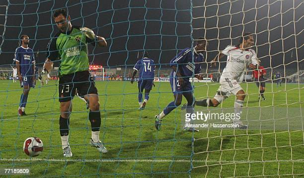 Hamit Altintop of Munich celebrates scoring the second goal during the first round second leg UEFA cup match between Belenenses Lisbonat and Bayern...