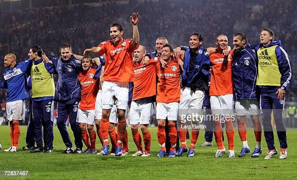 Hamit Altintop of Schalke celebrates with his team mates winning the Bundesliga match between Arminia Bielefeld and Schalke 04 at the Schuco Arena on...