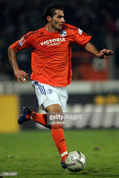 Hamit Altintop of Schalke runs with the ball during the Bundesliga match between Arminia Bielefeld and Schalke 04 at the Schuco Arena on December 16...