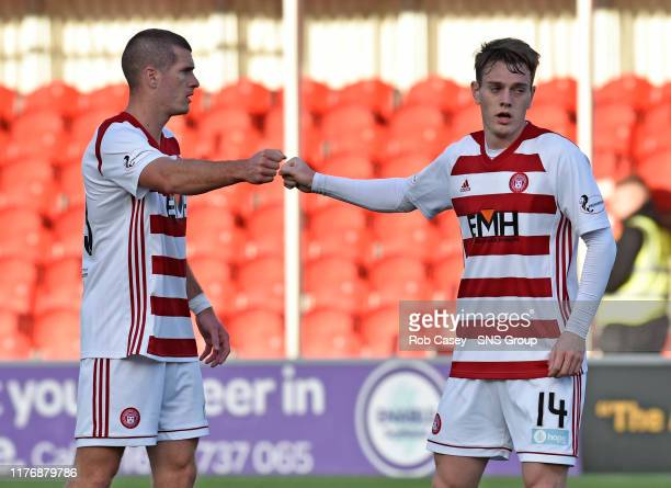 Hamitlons Ross Cunningham with Alex Gogic at full time of the Ladbrokes Premiership match between Hamilton and Hibernian at the FOY Stadium on...