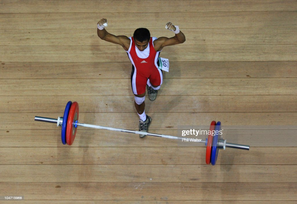 Hamizan Amirul Ibrahim of Malaysia celebrates a successful attempt in the Mens 56 kg weightlifting final during day one of the Delhi 2010 Commonwealth Games at Jawaharlal Nehru Sports Complex on October 4, 2010 in Delhi, India.