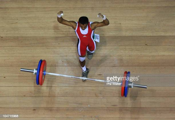 Hamizan Amirul Ibrahim of Malaysia celebrates a successful attempt in the Mens 56 kg weightlifting final during day one of the Delhi 2010...