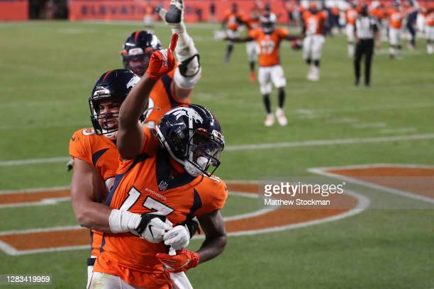 Hamler of the Denver Broncos celebrates with teammate Albert Okwuegbunam after scoring a touchdown against the Los Angeles Chargers at the end of the...