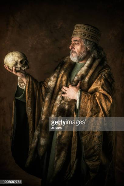 hamlet by william shakespear holding skull in his hands - acting stock pictures, royalty-free photos & images