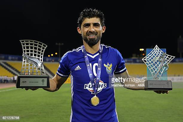 Hammadi Ahmed Abdullah of Air Force Club AlQuwa AlJawiya poses with trophies and his winners medal after the AFC Cup Final match between JSW...