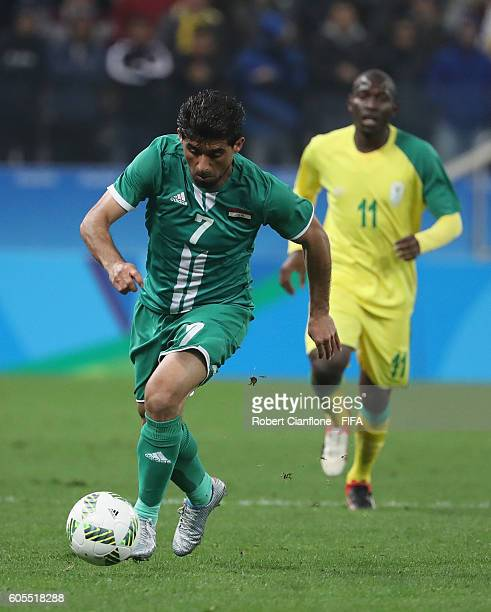 Hammadi Ahmed of Iraq runs with the ball during the Men's First Round Group A match between South Africa and Iraq on Day 5 of the Rio 2016 Olympic...