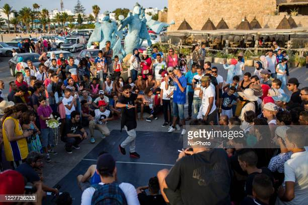 Hammamet, Tunisia, 11 August 2016. A growing audience is responding to events organized by the hip-hop community. The crowd watches a breakdance in...