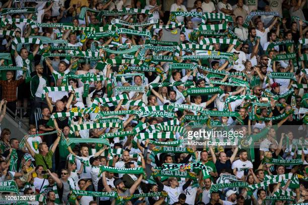 Hammarby IF fans hold up scarves during an Allsvenskan match between Hammarby IF and Djurgardens IF at Tele2 Arena on September 2 2018 in Stockholm...