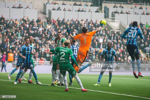 Hammarby IF goalkeeper Johan Wiland punches the ball away during a match between Djurgardens IF and Hammarby IF at Tele2 Arena on April 29 2018 in...