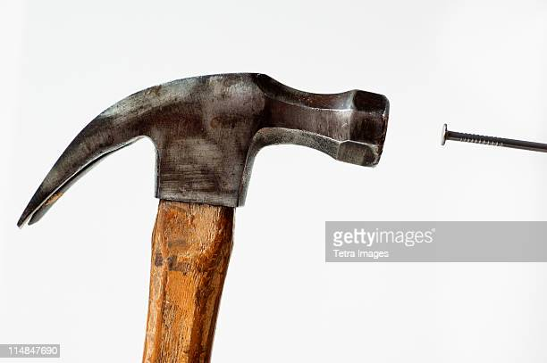 hammer and nail - hammer stock pictures, royalty-free photos & images
