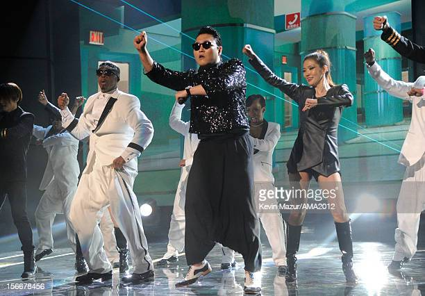 MC Hammer and singer PSY perform onstage during the 40th American Music Awards held at Nokia Theatre LA Live on November 18 2012 in Los Angeles...