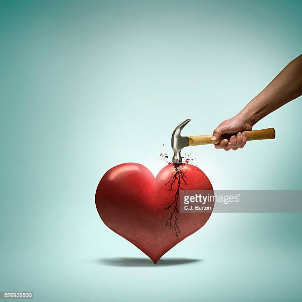 Hammer breaking a heart