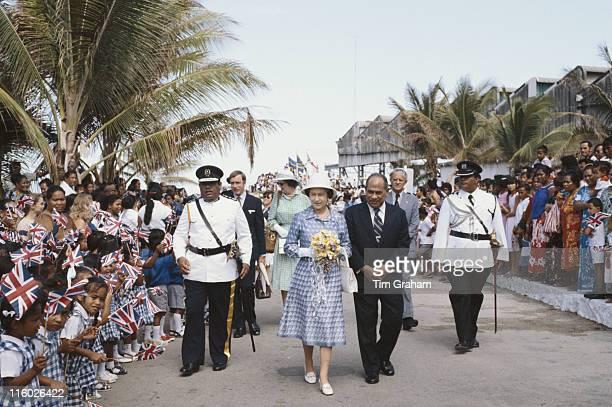 Hammer DeRoburt , President of the Republic of Nauru, and Queen Elizabeth II attend a garden party at the State House in Nauru, 21 October 1982. The...