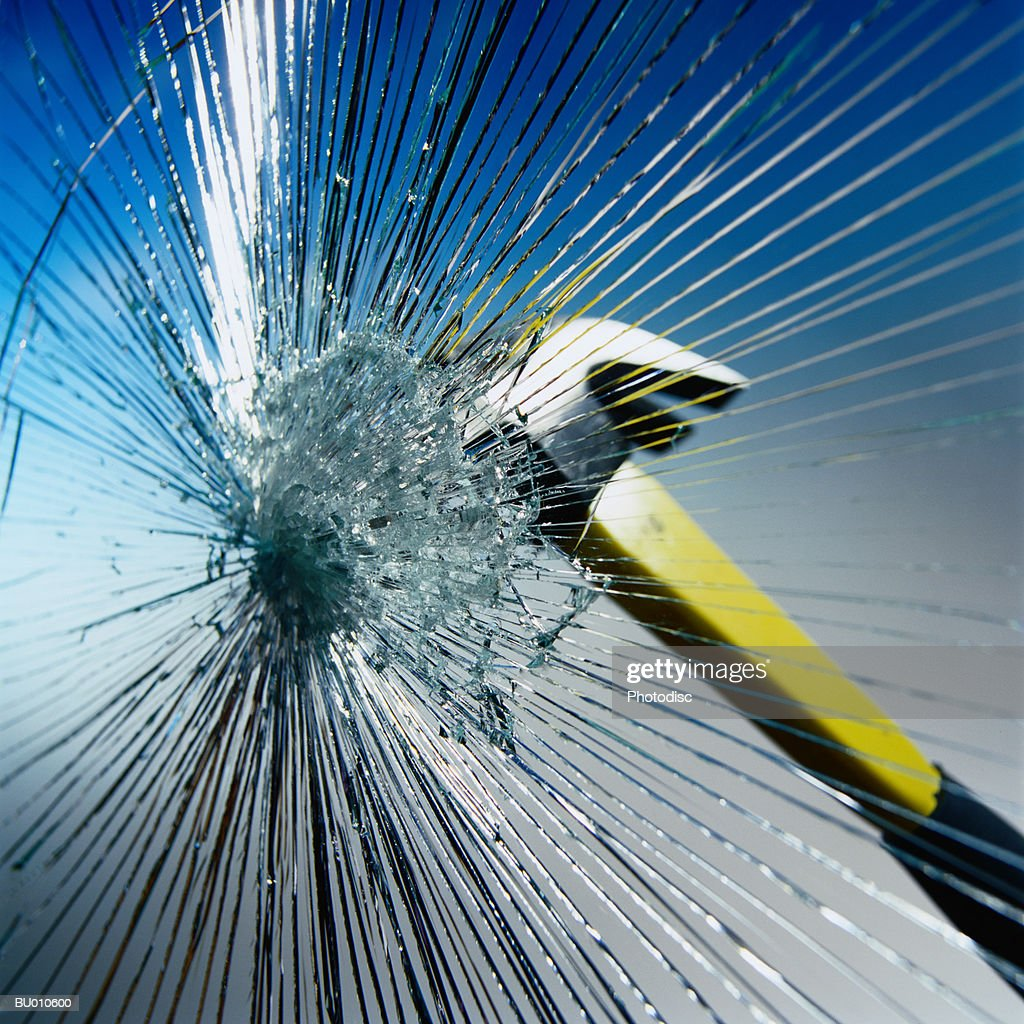 Hammer Hitting Glass : Stock Photo