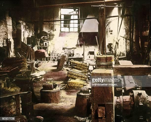 A hammer mill in the Eisenwurzen Lower Austria Handcolored lantern slide 1909