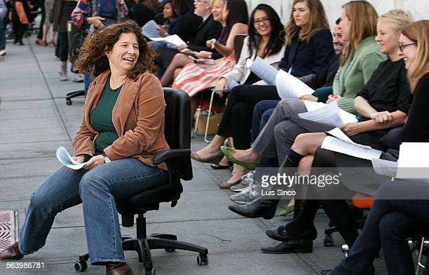 Hammer Museum employee Sarah Stifler wheels her office chair down the sidewalk Wednesday April 16 outside the museum in Westwood In an effort to...