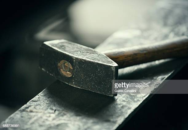 Hammer on iron anvil
