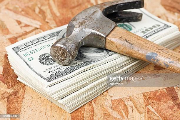 Martello sulla Pila di soldi