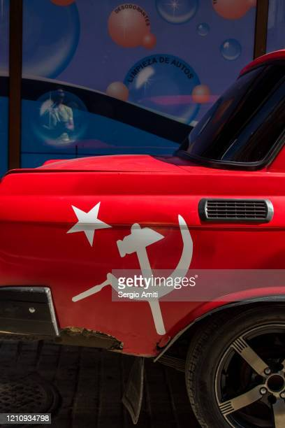 hammer sickle and star on red car - bandiera comunista foto e immagini stock