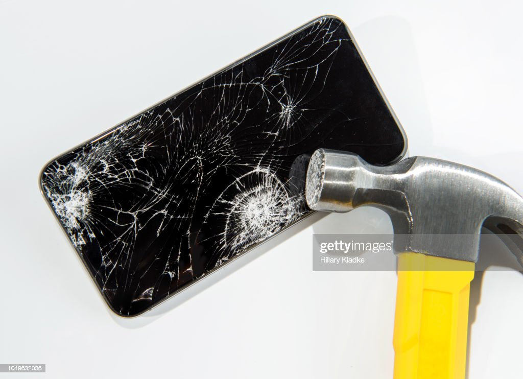 Hammer smashing a smart phone : Stock Photo