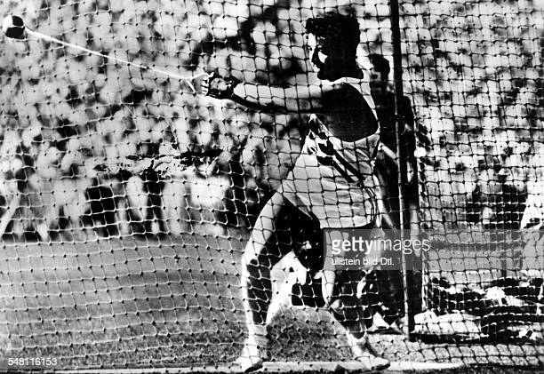 Hammer throwing men winner Harold Connolly during his turn