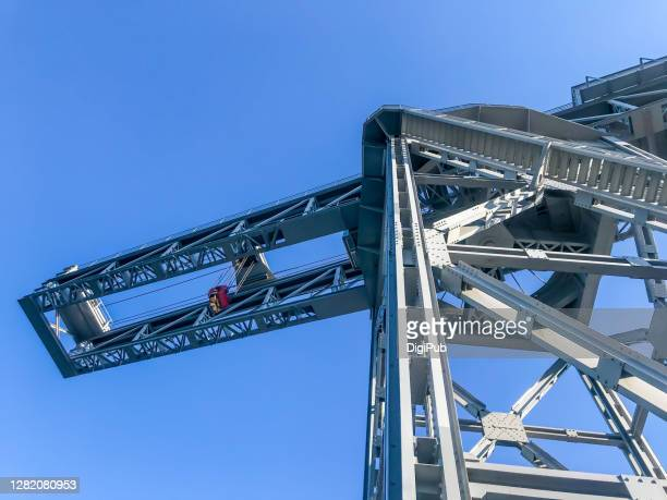 hammerhead crane against clear sky - harbour stock pictures, royalty-free photos & images