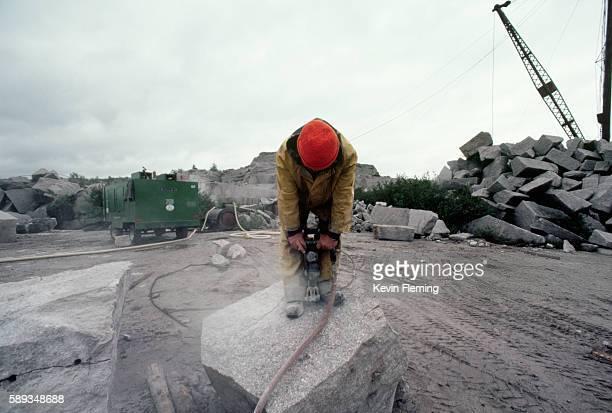Hammering a Peice of Granite