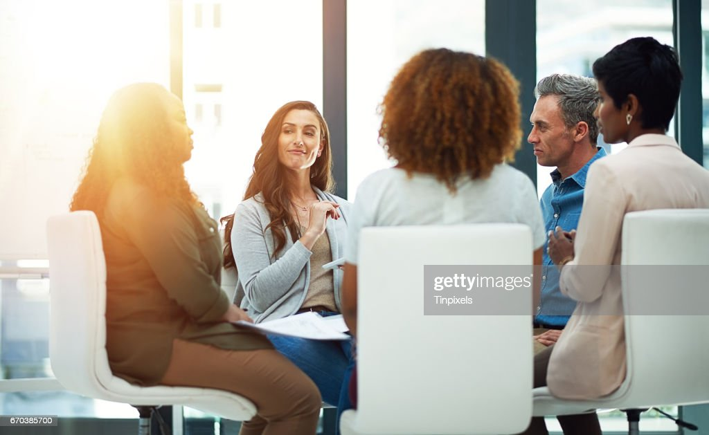 Hammering out some ideas with a creative collaboration : Stock Photo