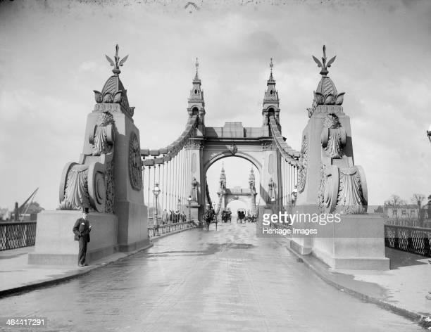 Hammersmith Bridge Hammersmith London c18871905 The bridge built by Sir Joseph Bazalgette in 18831887 taken from the south with elephantine ornament...
