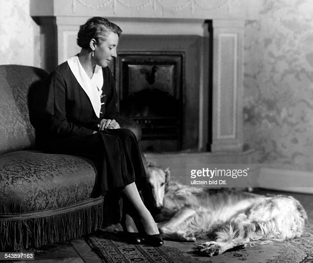 HammersteinEquord Baroness Maria of Nobleness Germany*18861970 nee baroness of Luettwitz with dog in front of the chimney Photographer Atelier Binder...