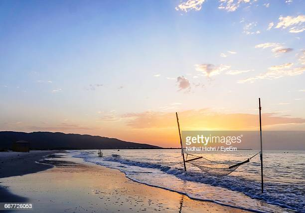 hammock at beach during sunset - sousse stock pictures, royalty-free photos & images