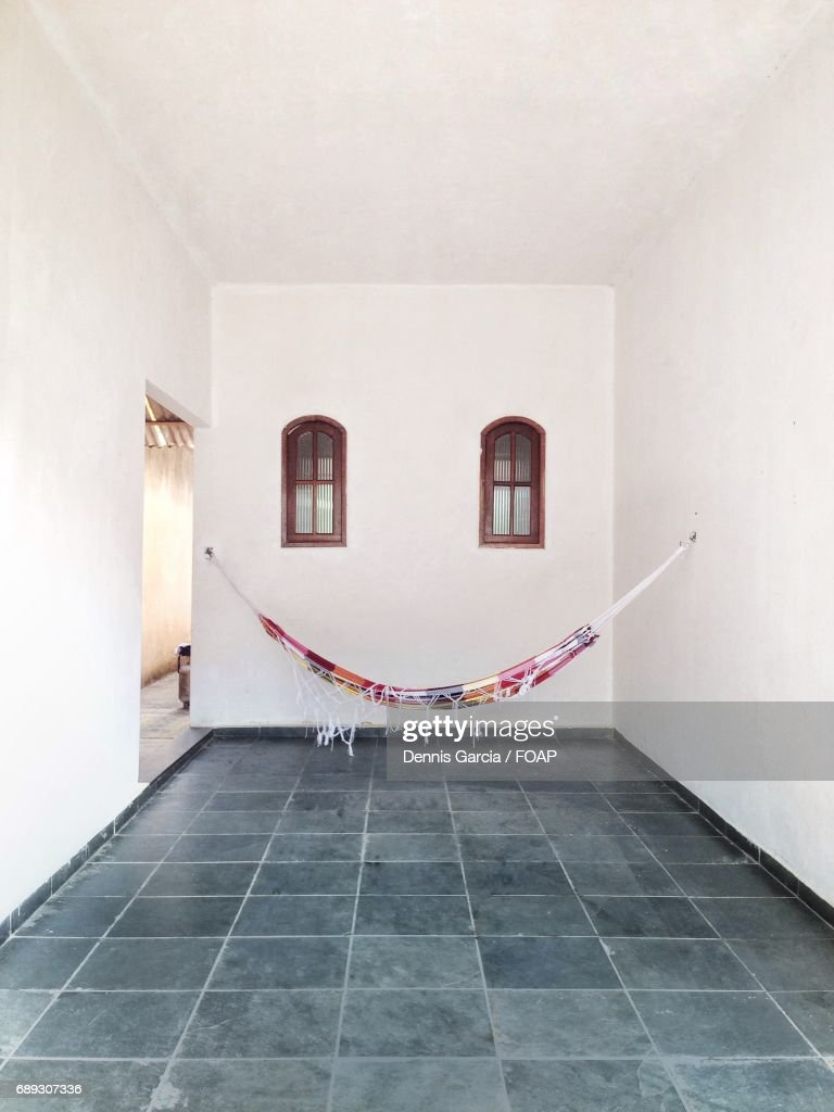 Hammock hanging in front view wall : Stock Photo