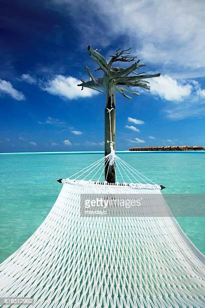 Hammock in the lagoon in Dhigufinolhu Island in Maldives, Indian Ocean