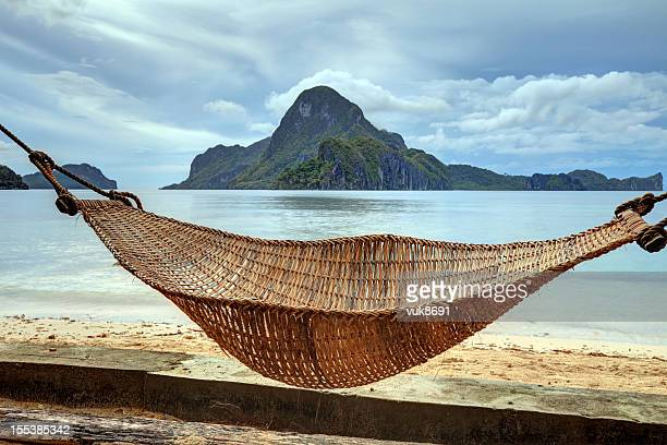 Hammock on a sandy beach, El Nido, Palawan island, Philippines