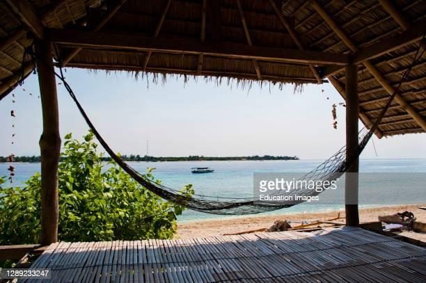 Hammock on Gili Meno with Gili Trawangan island in the background, Gili Islands, Indonesia, Asia, Asia.