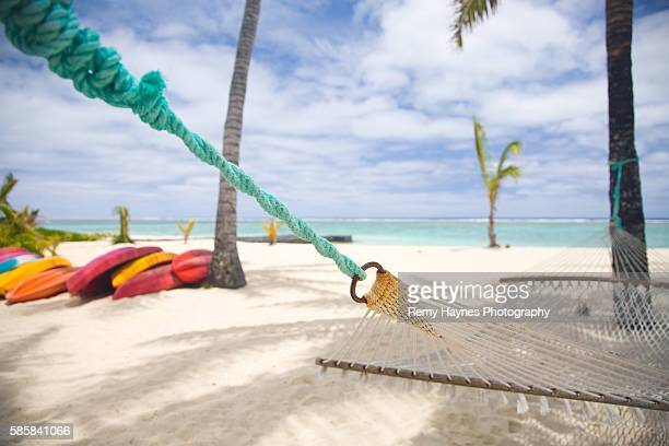 Hammock on Secluded Beach with Palm Trees in the Cook Islands